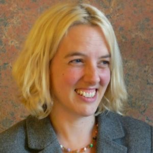 Profile of Lizzie Nelson, Director of Search for Common Ground UK, smiling
